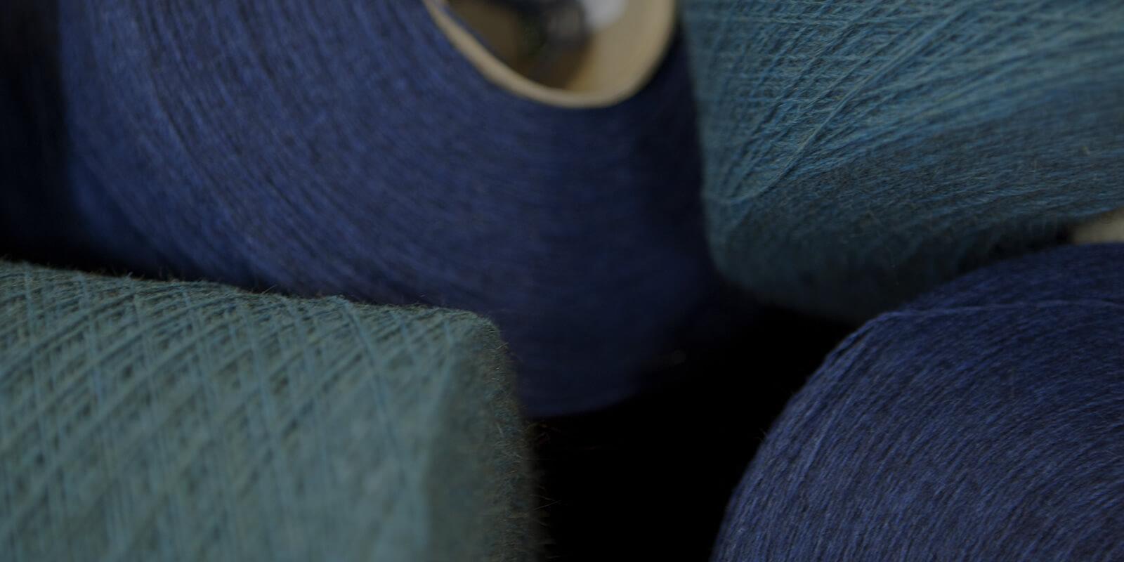 spools of blue yarn